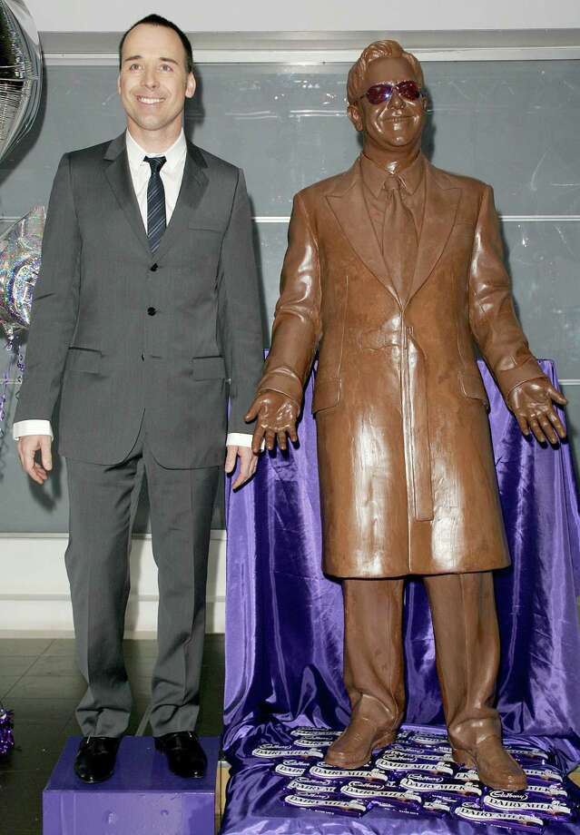 Sir Elton John was turned into a chocolate statue, thanks to a collaboration between Madame Tussaud's and Cadbury Dairy Milk to celebrate the latter's centenary. The 385-pound statue was unveiled by Elton's partner, David Furnish. Photo: Fred Duval, / / FilmMagic
