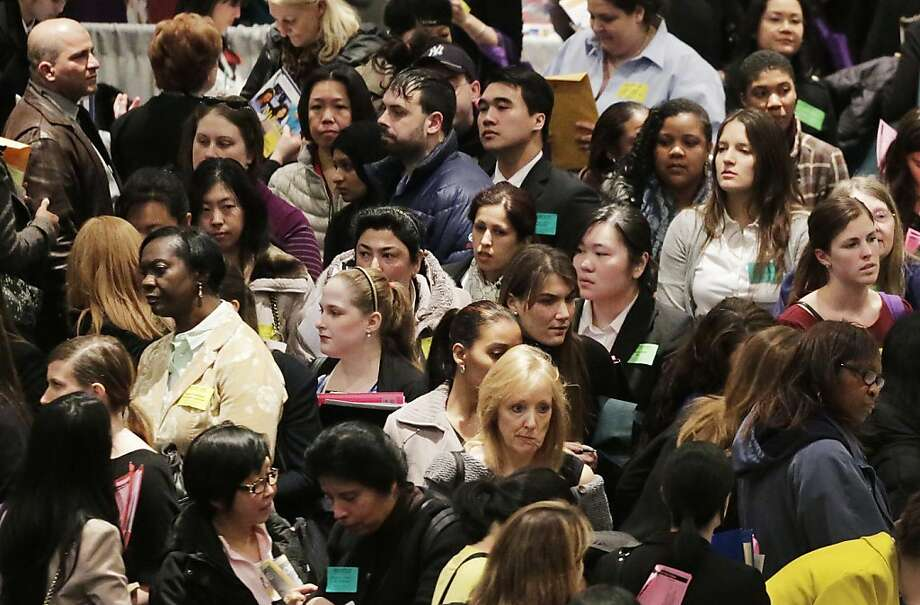 People crowd into a New York health care job fair Thursday, when the number of people seeking jobless benefits hit the second-lowest level in five years. Photo: Mark Lennihan, Associated Press
