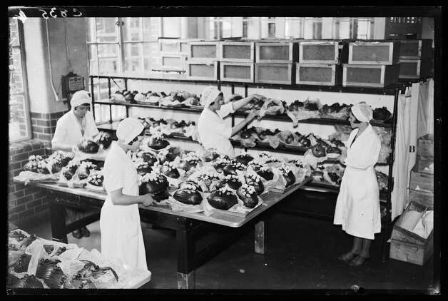 A photograph of workers wrapping chocolate Easter eggs at the Cadbury Brothers Ltd. factory in Bourneville, West Midlands, England, taken by George Woodbine for the Daily Herald newspaper on Feb. 23, 1933. Photo: Daily Herald Archive, / / Please read our licence terms. All digital images must be destroyed unless otherwise agreed in writing.