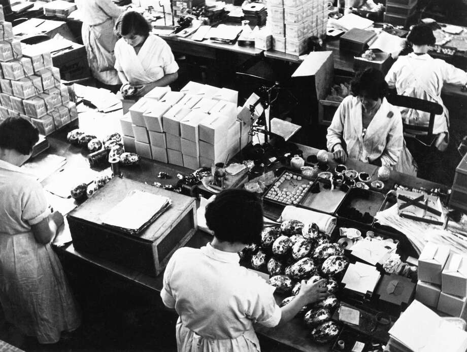 Manufacturing easter eggs at the Cadbury factory at Bourneville in Birmingham, England, pictured in the 1940s. Photo: Science Museum Photo Studio, / / NMeM Daily Herald Archive