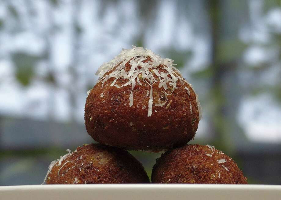 Chef Luca Della Casa incorporates Bolognese into his version of aracini, or rice balls. Photo: Billy Calzada / San Antonio Express-News