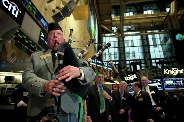 Joe Brady plays the bagpipes on the floor of the New York Stock Exchange March 14, 2013 in New York City. The Dow rose for a 10th straight day, in the longest streak since 1996. Photo: Allison Joyce, Getty Images / 2013 Getty Images