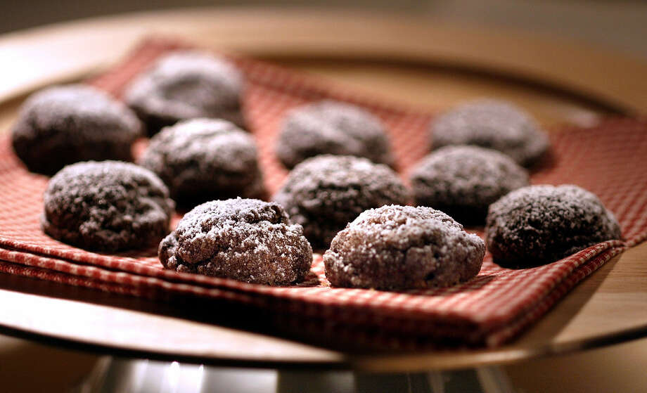 Chocolate sparkle cookies are made with ground almonds, no flour and lots of melted chocolate. Photo: Anne Cusack / Los Angeles Times