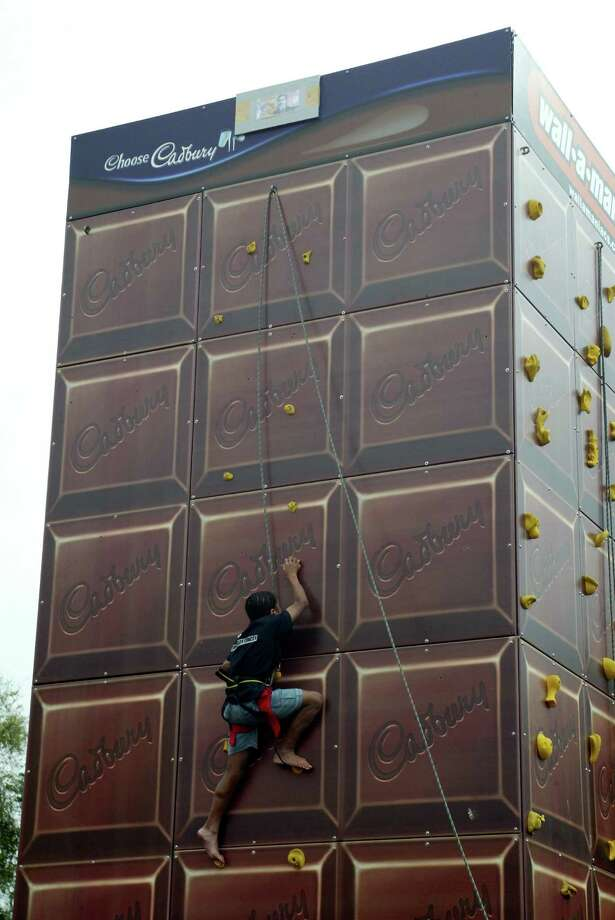 People try out the Cadbury climbing wall on April 11, 2004 at the the Auckland Royal Easter Show held at the Auckland Showgrounds, Auckland, New Zealand. Photo: Michael Bradley, / / 2004 Getty Images