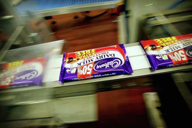 Cadbury's chocolate bars on the production line in the factory Feb. 25, 2005 in Birmingham, England. The company wsa celebrating 100 years of manufacturing at Bournville Cadbury factory. Photo: Graeme Robertson, / / 2005 Getty Images
