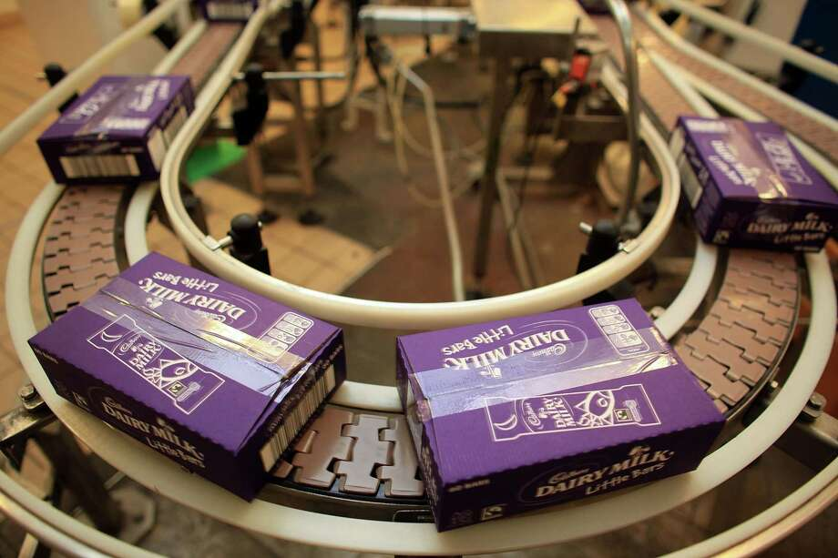 Cadbury's Dairy Milk chocolate bars move down the production line at the Cadbury's Bournville production plant on Dec. 15, 2009 in Birmingham, England. Photo: Christopher Furlong, / / 2009 Getty Images