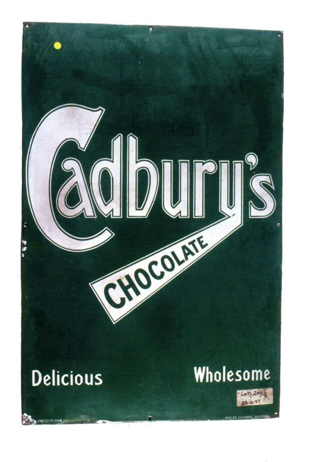 "Although solid chocolate for eating was not invented until the early 19th century, milk chocolate appeared in 1876, when it was developed by Daniel Peter, a Swiss confectioner. Cadbury's introduced its milk chocolate into the British market in 1905, and by 1913 Cadbury's Dairy Milk was the company's best selling brand. Cadbury's slogan ""a glass and a half of full cream milk in every half pound"" began in 1938, and their recipe for chocolate remained basically the same throughout its history. Photo: Science & Society Picture Librar, / / Please read our licence terms. All digital images must be destroyed unless otherwise agreed in writing."
