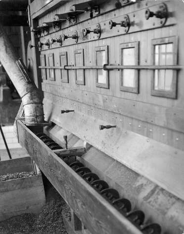 View of a machine used in the sorting and processing of cocoa beans at the Cadbury chocolate manufacturing plant, Bourneville, Birmingham, England, 1920. Photo: Mansell, / / Time & Life Pictures