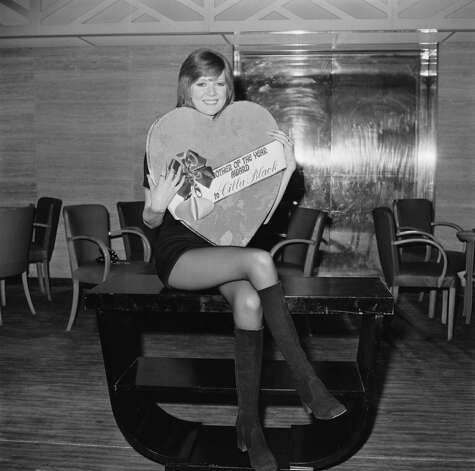 "English singer Cilla Black at the Savoy Hotel, London, with a special presentation box of chocolates, her award after being chosen as the Mothers' Day ""personality mother of the year"" by British sweetshop owners, March 18, 1971. The award was presented by Cadbury Director Dominic Cadbury. Photo: Frank Barratt, / / 2010 Getty Images"
