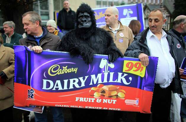 An employee of Cadbury, dressed as a gorilla, joins workers to show their support for Cadbury as they and their union Unite launched their campaign to protect the company's independence on Dec. 15, 2009 in Birmingham, England. Photo: Christopher Furlong, / / 2009 Getty Images