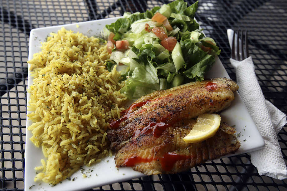 A North African spice blend with a touch of heat accents a tilapia fillet in a Moroccan Fish Plate. Photo: Tom Reel / San Antonio Express-News