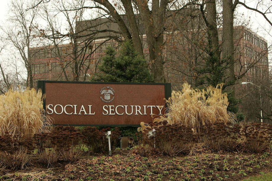 A sign marks the entrance to the headquarters of the Social Security Administration. Don't listen to scare tactics, Social Security is doing fine. Photo: Dennis Brack, Bloomberg News