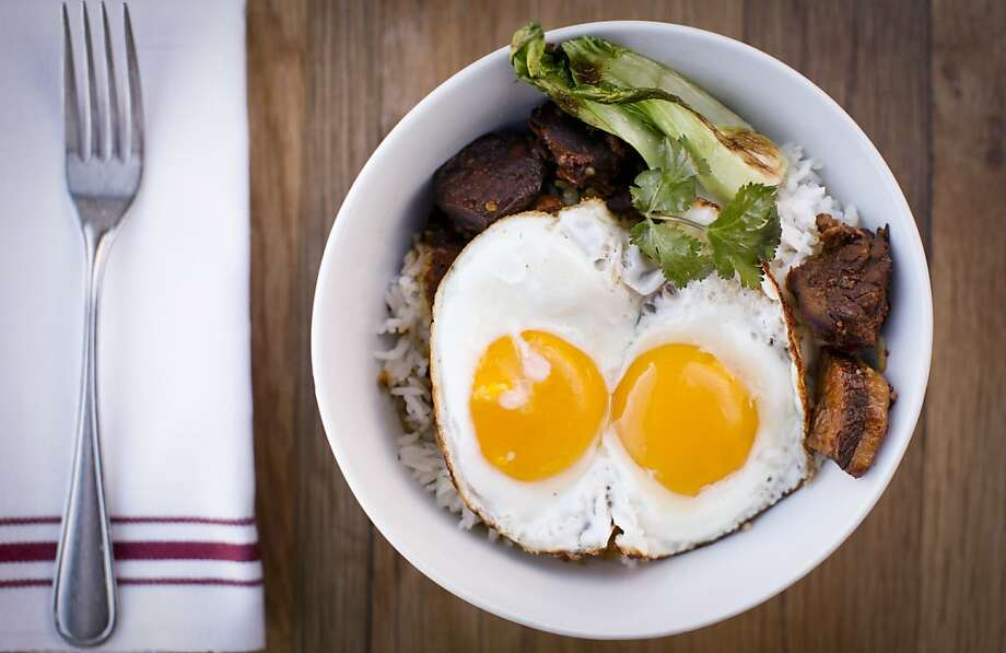 The Chinese breakfast at Plow, which usually sells out, features tender pork, lightly crisped baby bok choy, and two farm fresh eggs and their sunny yolks. Photo: Russell Yip, The Chronicle