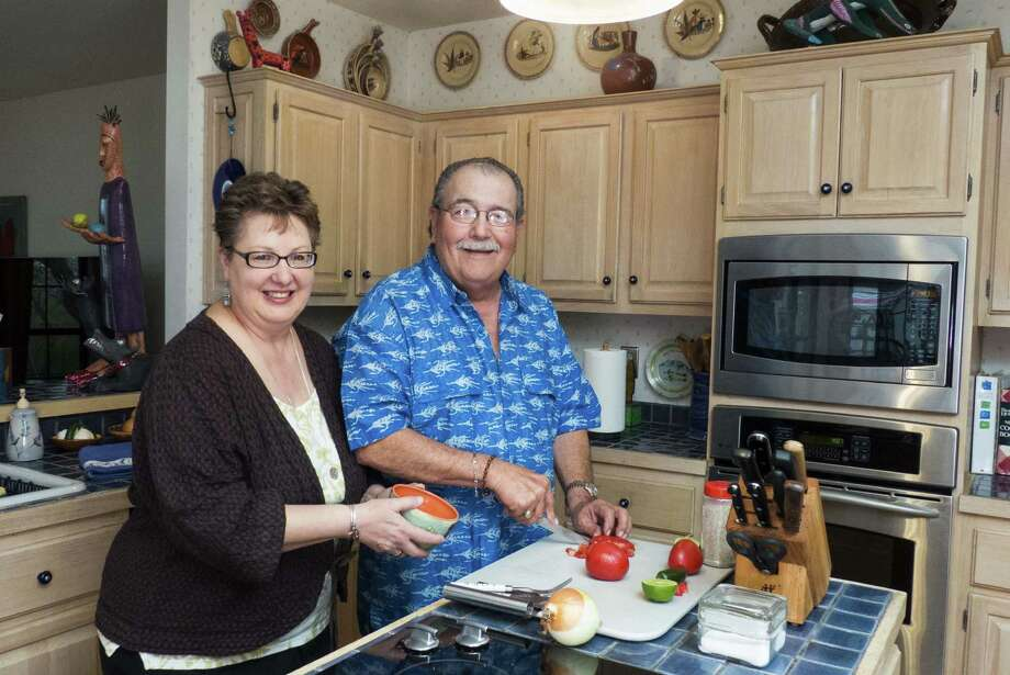 Alicia and Augie Vargas divide work in the kitchen: He cooks and she decorates. Photo: Billy Calzada / San Antonio Express-News