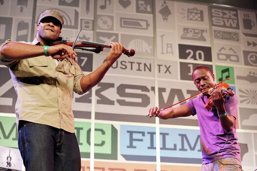 Black Violin's Kev Marcus (left) and Wil B perform at the Austin Convention Center during South by Southwest Thursday March 14, 2013 in Austin, TX. Photo: Edward A. Ornelas, San Antonio Express-News / © 2013 San Antonio Express-News
