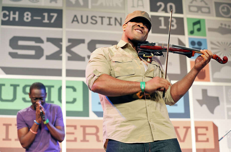 Black Violin's Wil B (left) and Kev Marcus perform at the Austin Convention Center during South by Southwest Thursday March 14, 2013 in Austin, TX. Photo: Edward A. Ornelas, San Antonio Express-News / © 2013 San Antonio Express-News