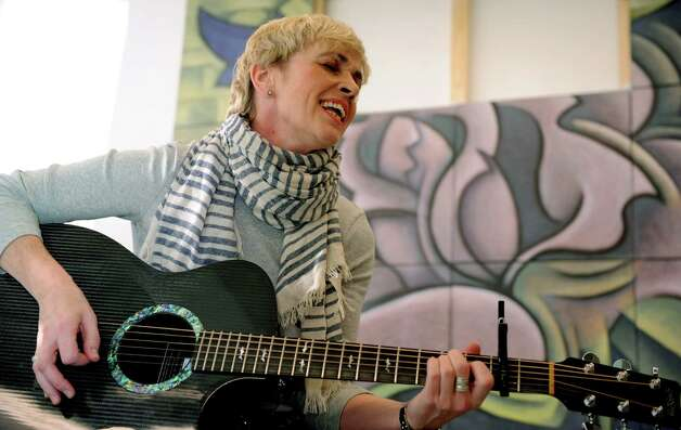 Stamford singer and songwriter Kathy Muir plays the original song she wrote for a collaboration with filmmaker Markus Innocenti and Greenwich artist Paul Larson at the Loft Artists Association in Stamford on Wednesday, February 20, 2013. Photo: Lindsay Perry / Stamford Advocate