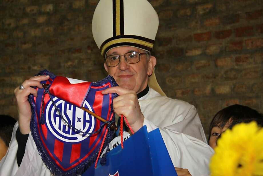 In this March 24, 2011 image released by the San Lorenzo de Almagro soccer team on March 13, 2013, Argentina's Cardinal Jorge Bergoglio holds up a small flag of the San Lorenzo soccer team in Buenos Aires, Argentina.  Bergoglio, a San Lorenzo soccer fan, was chosen as Pope on March 13, 2013, the first pope ever from the Americas and the first from outside Europe in more than a millennium. (AP Photo/Club Atletico San Lorenzo de Almagro) Photo: Associated Press