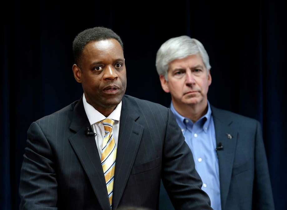 Kevyn Orr, left, picked by Gov. Rick Snyder as emergency manager for Detroit, must be confirmed. Photo: Paul Sancya, STF / AP