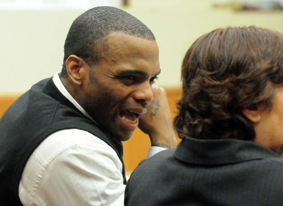 James Wells, who is on trial for allegedly killing 15-year-old Schenectady resident Eddie Stanley, speaks with his attorney, Cheryl Coleman, before opening statements Thursday morning, Feb. 7, 2013, in Schenectady County Courthouse. (Marc Schultz/Pool photographer) Photo: Marc Schultz