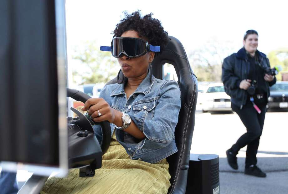 "Kimberly Samuels reacts as she gets pulled over by the ""police"" while she rides the Texas A&M's Agrilife Extension Service's DWI Prevention Simulator with Fatal Vision goggles during TxDOT's Buzzed Driving Campaign event to remind motorists that spring marks the most dangerous seasons on Texas roadways. Photo: Karen Warren, Houston Chronicle / © 2013 Houston Chronicle"