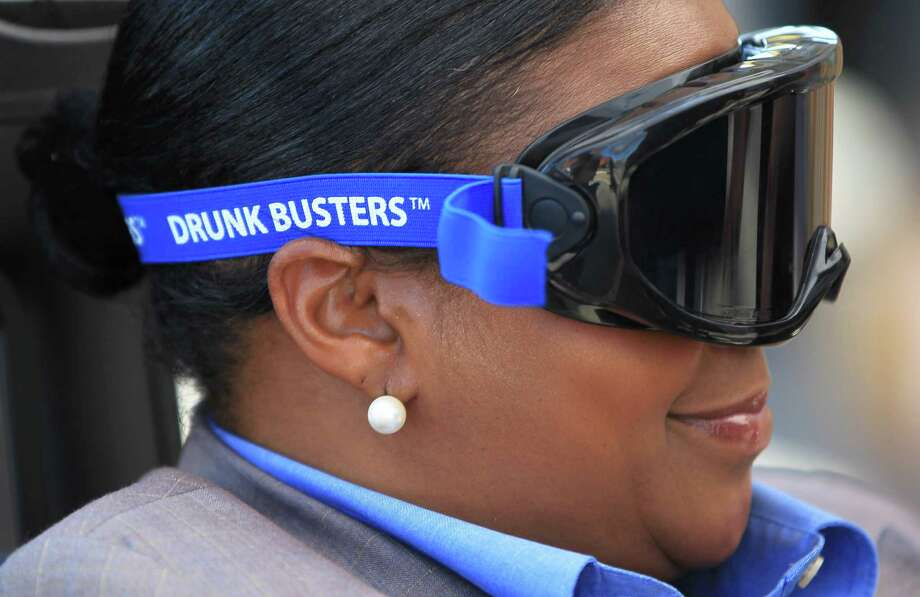 Glenda Walton, an intern with MADD, rides the Texas A&M's Agrilife Extension Service's DWI Prevention Simulator with Fatal Vision goggles. Photo: Karen Warren, Houston Chronicle / © 2013 Houston Chronicle
