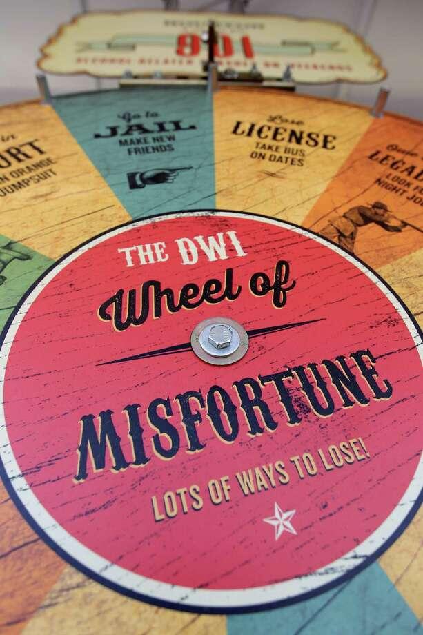 "Wheel of Misfortune in the ""DWI Not So Fun House."" Photo: Karen Warren, Houston Chronicle / © 2013 Houston Chronicle"