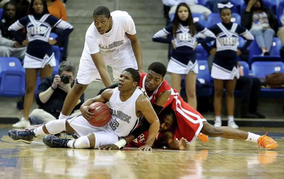 Mike Ross Connecticut Post freelance -Fairfield Prep's #44 Paschal Chukwu and #3 Kieth Pettway battle for a loose ball against Hillhouse's #12 Corey Staggers and #11 Chaise Daniels during first haf action of Tuesday evening SCC championship game.  Hillhouse would win 53-47. Photo: Mike Ross / www.mikerossphoto.com