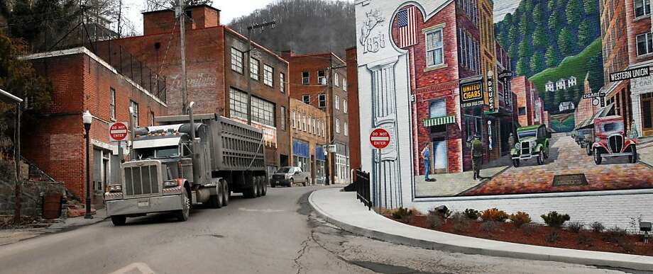 In the last year, Maine joined West Virginia as the only two states where overall deaths exceed births. Here, a coal truck drives out of the business district of Welch, W.Va. Photo: Jon C. Hancock, Associated Press