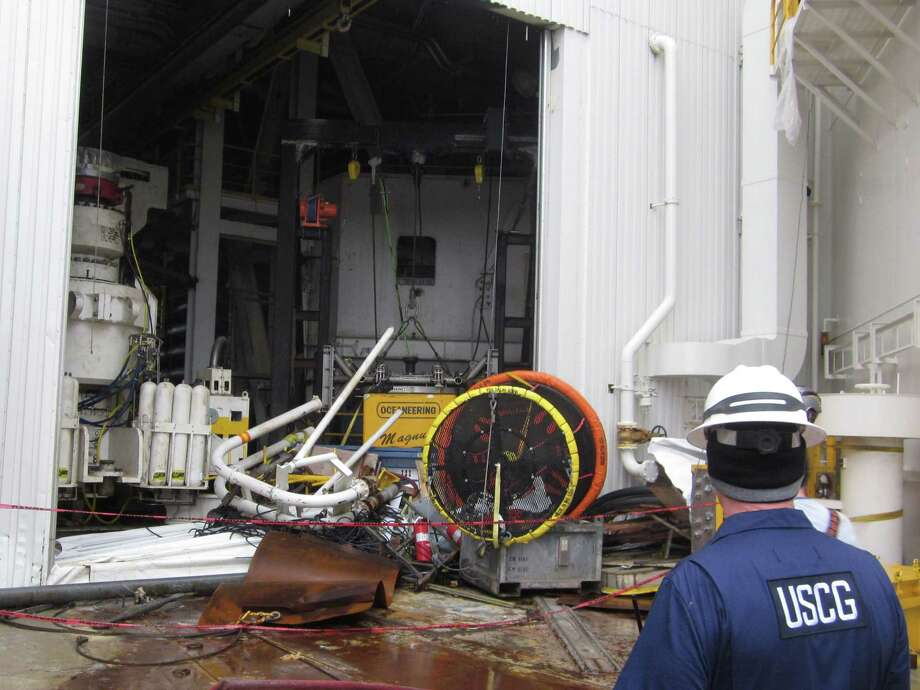 An inspector looks over damaged equipment on the Shell Arctic drilling rig Kulluk. The government plans a closer watch on Shell's Arctic drilling operations. Photo: HOPD / U.S. Coast Guard