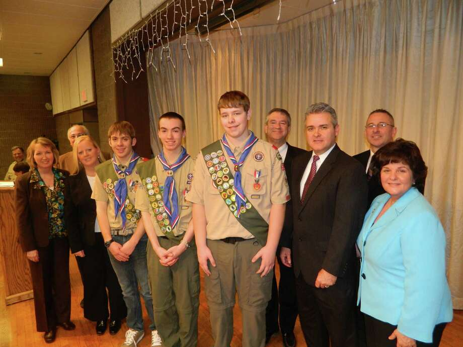 Boy Scouts of America Troop 528 bestowed Eagle Scout honors to three troop members at a ceremony March 10 at the Poestenkill Fire House: Justin Arsenault, Andrew Glanton and Joshua Glasser. From left, Rensselaer County Executive Kathleen Jimino, Poestenkill Supervisor Dominic Jacangelo, county Legislator Kelly Hoffman, Glasser, Glanton, Arsenault, Vice Chairman of the Legislature Phil Danaher, Assemblyman Steve McLaughlin, Legislator Leon Fiacco and State Senator Kathy Marchione. (Submitted photo)