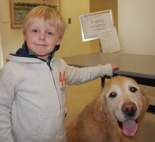 "Cameron Jaffe, 3, and Cheerio, his 12-year-old golden retriever, at Thursday's ""Westport Top Dog"" contest. Cheerio won second place in the annual celebration of local canines.  WESTPORT NEWS, CT 3/14/13 Photo: Jarret Liotta / Westport News contributed"