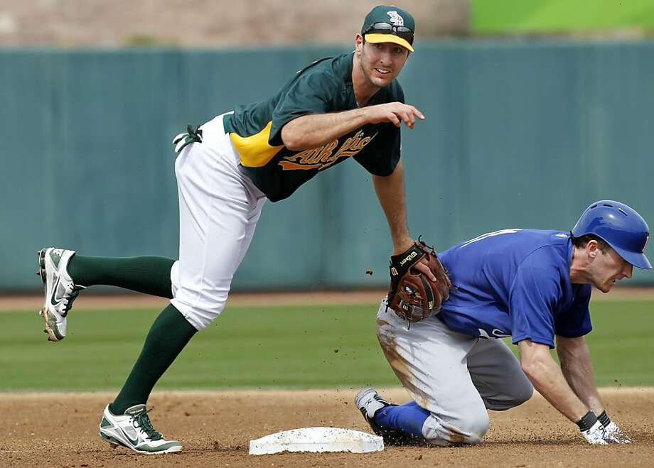 Athletic's Adam Rosales, (17) forces out Itlay's Chris Denorfria, (11) at second and completes a double play in the first inning, as the Oakland Athletics went on to beat the WBC team Italy 4-3 at Phoenix Municipal Stadium during spring training action on Tuesday Mar. 5, 2013, in Phoenix, Az. Photo: Michael Macor, The Chronicle