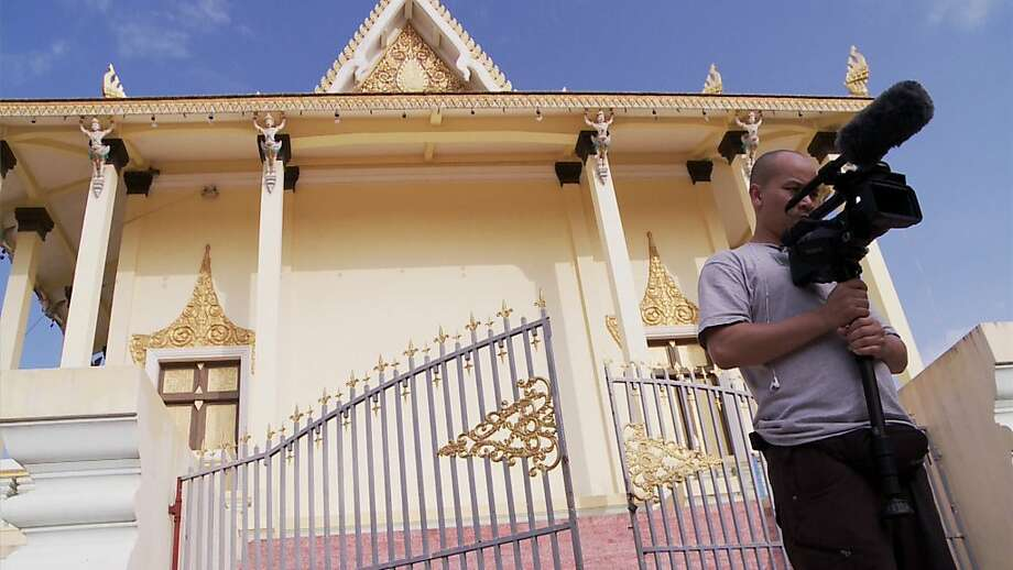 Michael Siv, who grew up in S.F., works on his documentary outside a temple in Cambodia.