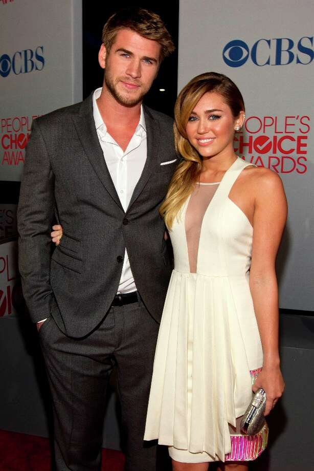 Actor Liam Hemsworth and Actress Miley Cyrus attends People's Choice Awards 2012 at Nokia Theatre LA Live on January 11, 2012 in Los Angeles, California. Photo: Christopher Polk, Getty Images For PCA / 2012 Getty Images