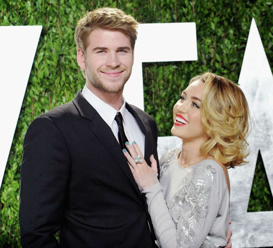 Actor Liam Hemsworth and actress/singer Miley Cyrus arrive at the 2012 Vanity Fair Oscar Party at Sunset Tower on February 26, 2012 in West Hollywood, California. Photo: Jon Kopaloff, FilmMagic / 2012 Jon Kopaloff