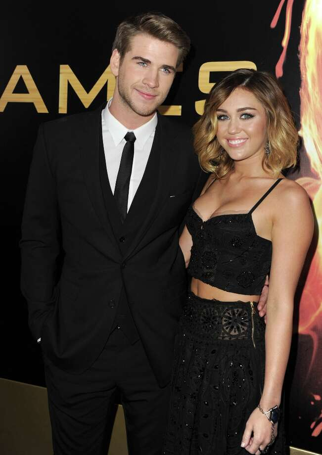 Actor Liam Hemsworth (L) and singer Miley Cyrus arrive at the premiere of Lionsgate's The Hunger Games at Nokia Theatre L.A. Live on March 12, 2012 in Los Angeles, California. Photo: Kevin Winter, Getty Images / 2012 Getty Images