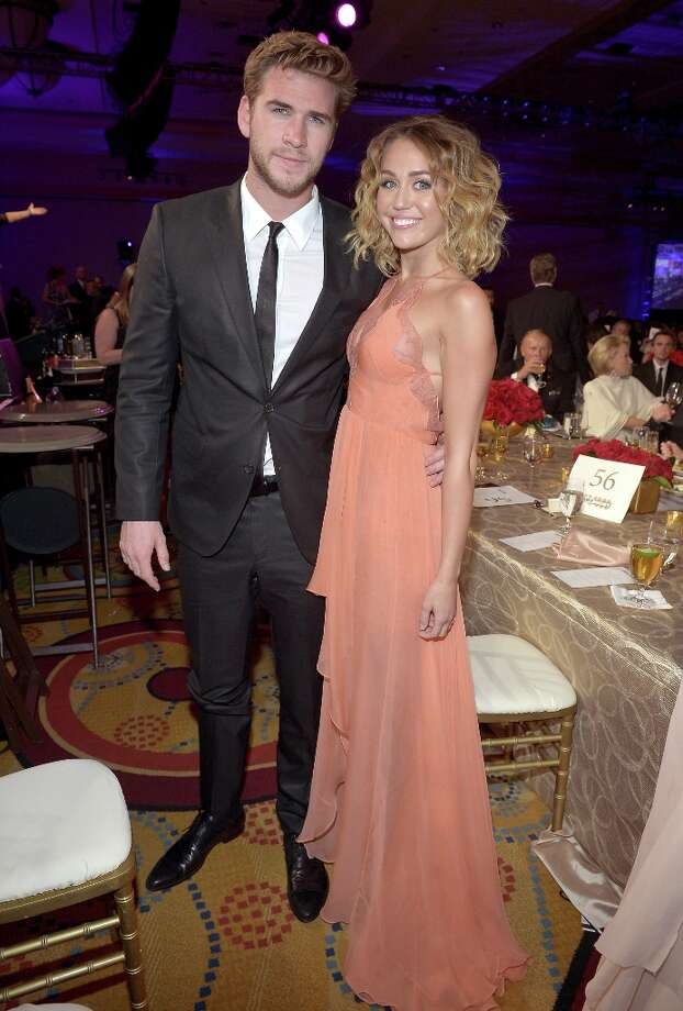 Actor Liam Hemsworth (L) and singer/actress Miley Cyrus attend Muhammad Ali's Celebrity Fight Night XVIII held at JW Marriott Desert Ridge Resort & Spa on March 24, 2012 in Phoenix, Arizona. Photo: Charley Gallay / 2012 Getty Images
