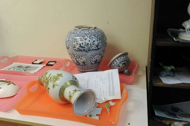 Broken ceramics is in a box for Morty Bachar, co-owner, of Lakeside Pottery in Stamford, Conn., Monday, 11, 2013, to repair at his shop which brings a national clientele. Photo: Helen Neafsey / Greenwich Time