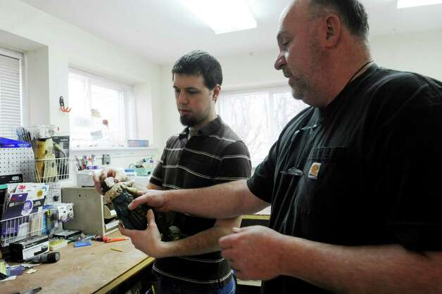Jon Puzzvoli, left, and Morty Bachar, co-owner, of Lakeside Pottery in Stamford, Conn., Monday, March, 11, 2013, working on a ceramics, at his shop which brings a national clientele. Photo: Helen Neafsey / Greenwich Time