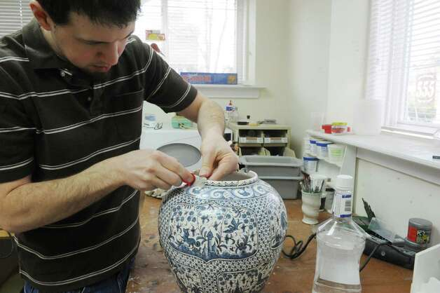 Jon Puzzuoli of Lakeside Pottery in Stamford, Conn., Monday, March 11, 2013, repairs ceramics, pottery or a stone sculpture at the shop which brings a national clientele. Photo: Helen Neafsey / Greenwich Time
