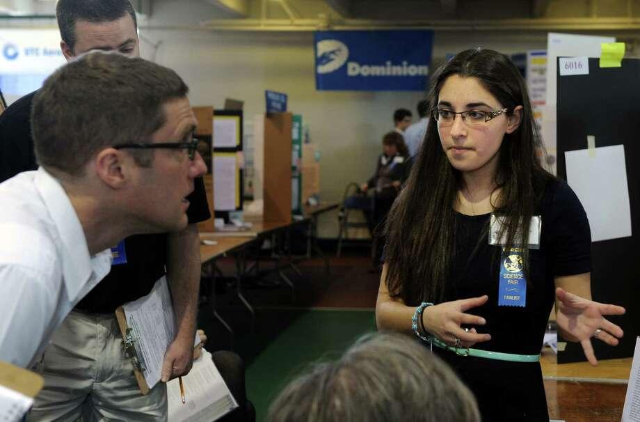 Sofia Bramante, a junior at Fairfield Warde High School, explains her project during judging for the Connecticut Science & Engineering Fair Thursday, Mar. 14, 2013 at Quinnipiac University in Hamden, Conn. Photo: Autumn Driscoll / Connecticut Post