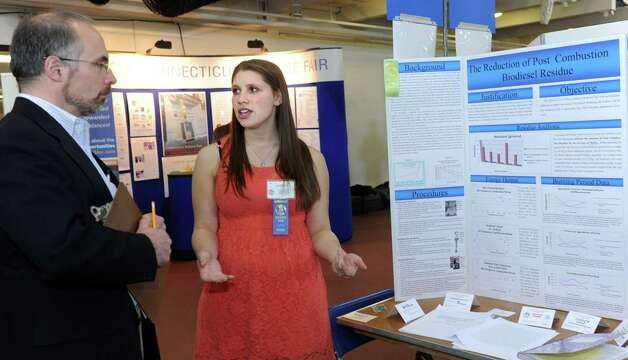 Julia Elstein, of Trumbull, a senior at Bridgeport Regional Aquaculture School, talks with judge Phil Surato, of The United Illuminating Company, during judging for the Connecticut Science & Engineering Fair Thursday, Mar. 14, 2013 at Quinnipiac University in Hamden, Conn. Photo: Autumn Driscoll / Connecticut Post