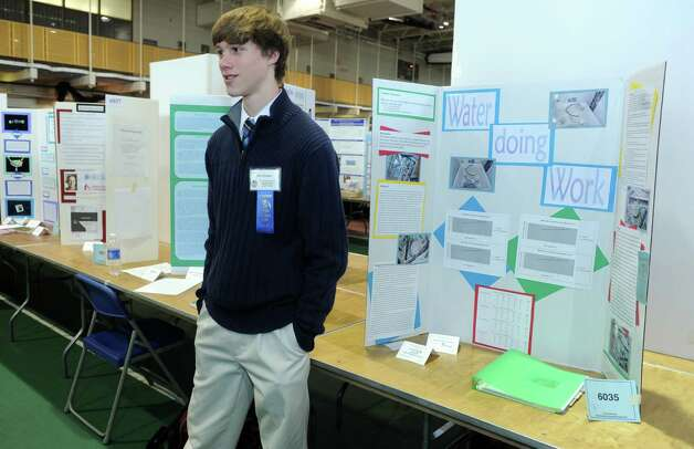 Brian Westgate, a junior at Oxford High School, stands by his project during judging for the Connecticut Science & Engineering Fair Thursday, Mar. 14, 2013 at Quinnipiac University in Hamden, Conn. Photo: Autumn Driscoll / Connecticut Post