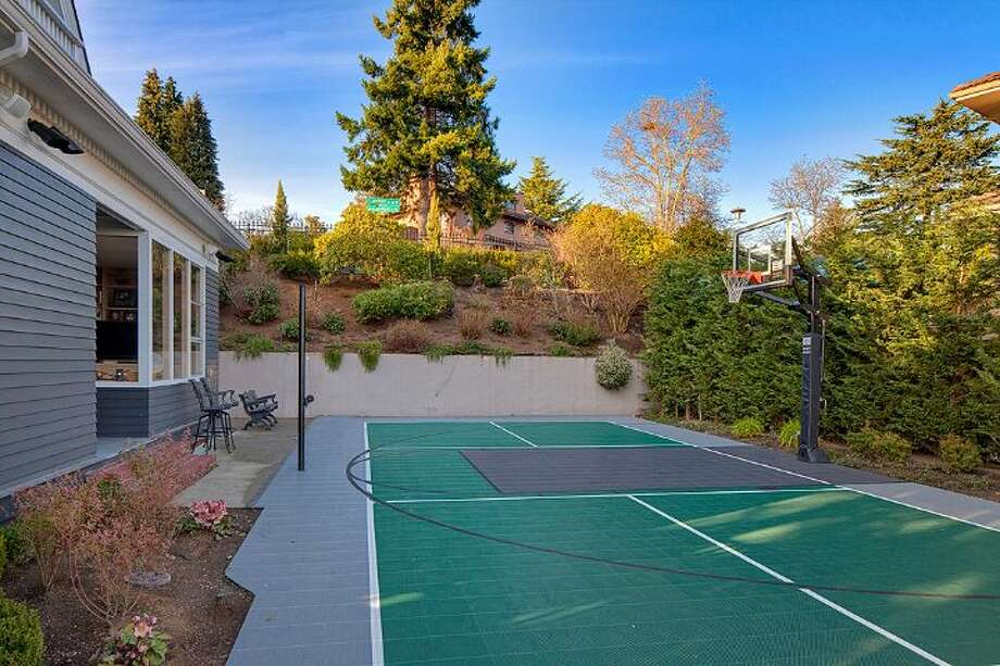 Sport court of 3008 Webster Point Road N.E. The 7,404-square-foot mansion, built in 1910, has seven bedrooms, 4.5 bathrooms, a sunroom, a den, a game room, a media room, leaded glass, massive moldings, a dock with a boat lift and views of Lake Washington and the Cascade Mountains on a 0.41-acre lot. It's listed for $4.75 million. Photo: Courtesy Kim Knowles And Tom Maider/Windermere Real Estate