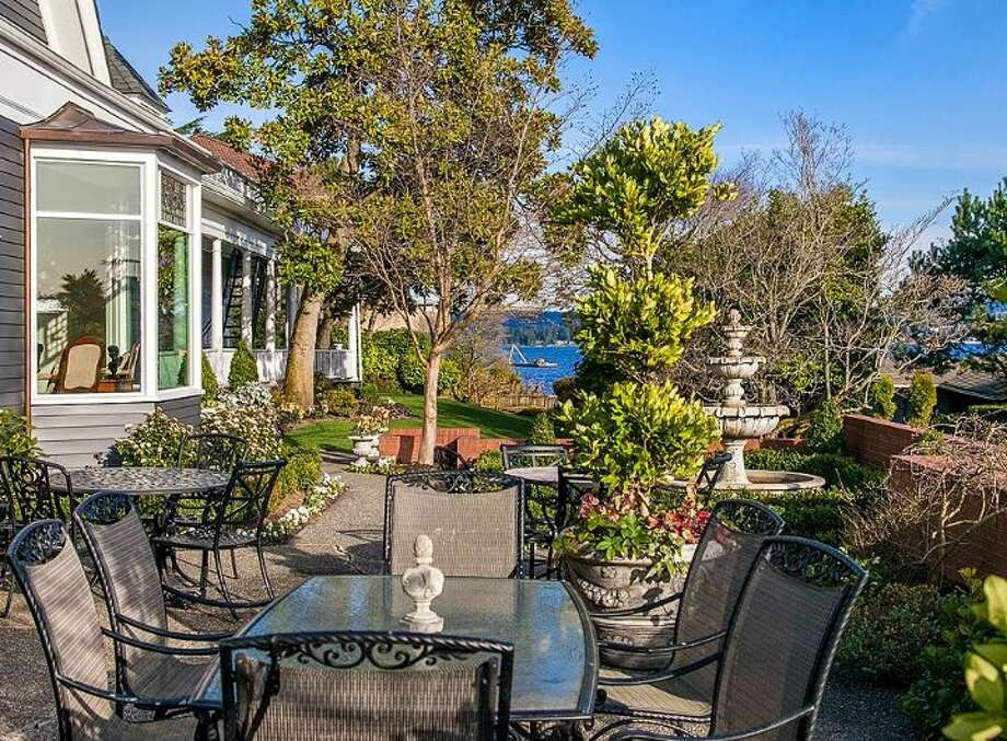 Patio of 3008 Webster Point Road N.E. The 7,404-square-foot mansion, built in 1910, has seven bedrooms, 4.5 bathrooms, a sunroom, a den, a game room, a media room, leaded glass, massive moldings, sport and tennis courts, a dock with a boat lift and views of Lake Washington and the Cascade Mountains on a 0.41-acre lot. It's listed for $4.75 million. Photo: Courtesy Kim Knowles And Tom Maider/Windermere Real Estate
