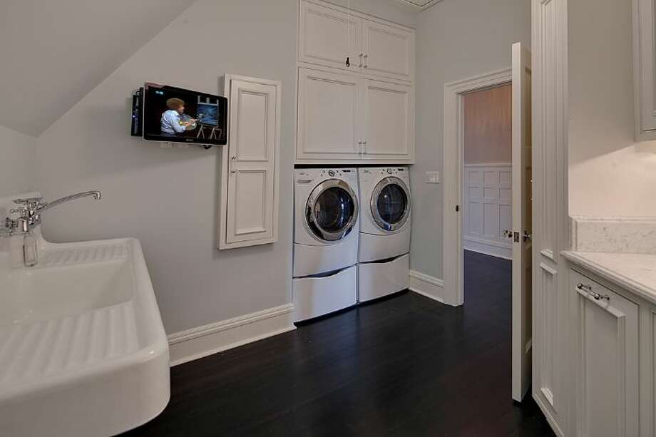 Laundry room of 3008 Webster Point Road N.E. The 7,404-square-foot mansion, built in 1910, has seven bedrooms, 4.5 bathrooms, a sunroom, a den, a game room, a media room, leaded glass, massive moldings, sport and tennis courts, a dock with a boat lift and views of Lake Washington and the Cascade Mountains on a 0.41-acre lot. It's listed for $4.75 million. Photo: Courtesy Kim Knowles And Tom Maider/Windermere Real Estate