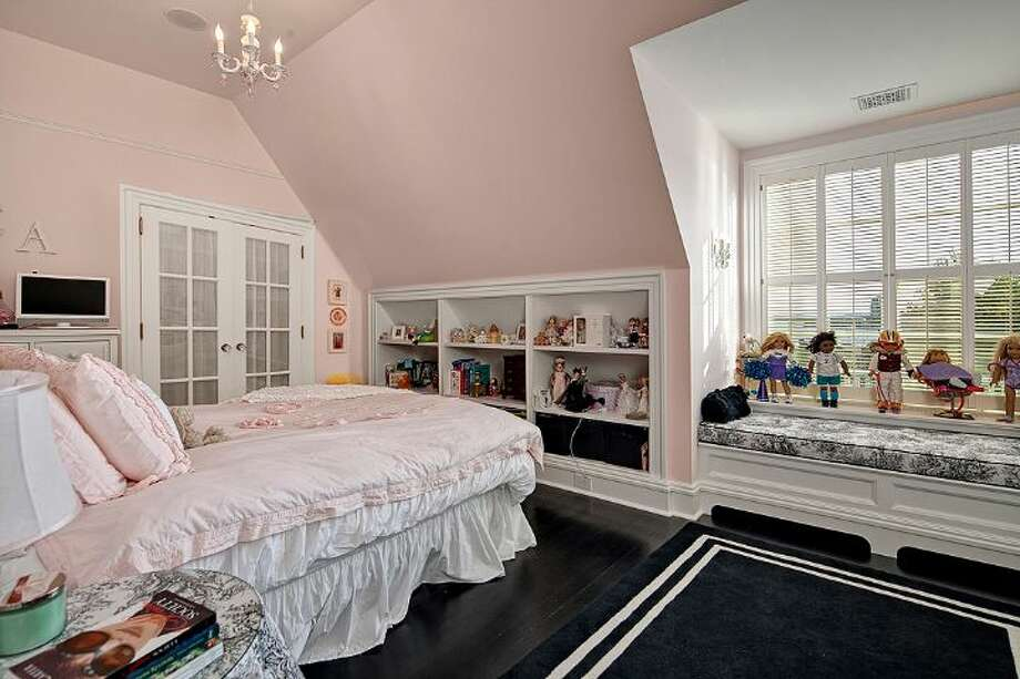 Bedroom of 3008 Webster Point Road N.E. The 7,404-square-foot mansion, built in 1910, has seven bedrooms, 4.5 bathrooms, a sunroom, a den, a game room, a media room, leaded glass, massive moldings, sport and tennis courts, a dock with a boat lift and views of Lake Washington and the Cascade Mountains on a 0.41-acre lot. It's listed for $4.75 million. Photo: Courtesy Kim Knowles And Tom Maider/Windermere Real Estate