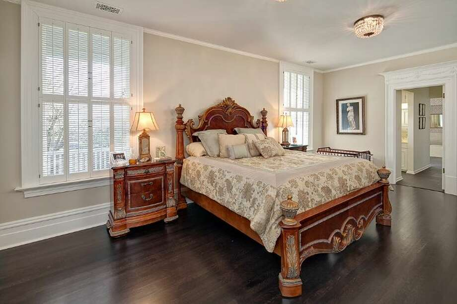 Main floor master bedroom of 3008 Webster Point Road N.E. The 7,404-square-foot mansion, built in 1910, has seven bedrooms, 4.5 bathrooms, a sunroom, a den, a game room, a media room, leaded glass, massive moldings, sport and tennis courts, a dock with a boat lift and views of Lake Washington and the Cascade Mountains on a 0.41-acre lot. It's listed for $4.75 million. Photo: Courtesy Kim Knowles And Tom Maider/Windermere Real Estate