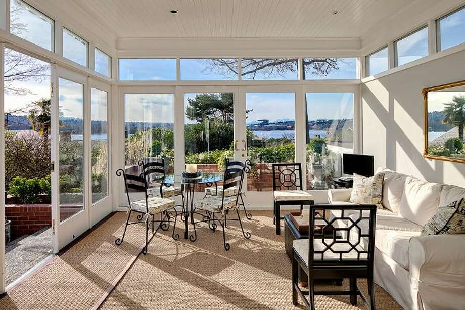 Sunroom of 3008 Webster Point Road N.E. The 7,404-square-foot mansion, built in 1910, has seven bedrooms, 4.5 bathrooms, a den, a game room, a media room, leaded glass, massive moldings, sport and tennis courts, a dock with a boat lift and views of Lake Washington and the Cascade Mountains on a 0.41-acre lot. It's listed for $4.75 million. Photo: Courtesy Kim Knowles And Tom Maider/Windermere Real Estate